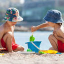two-cute-kids-playing-sand-beach-toys-42303339